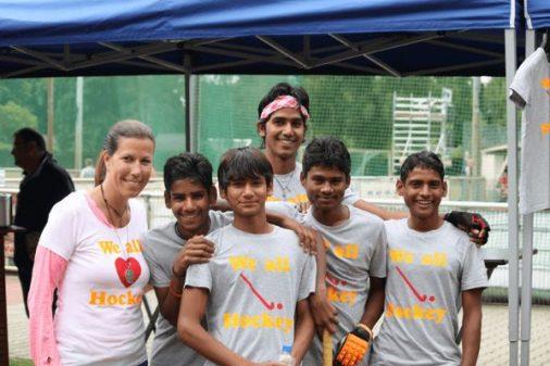 Andrea with village hockey boys